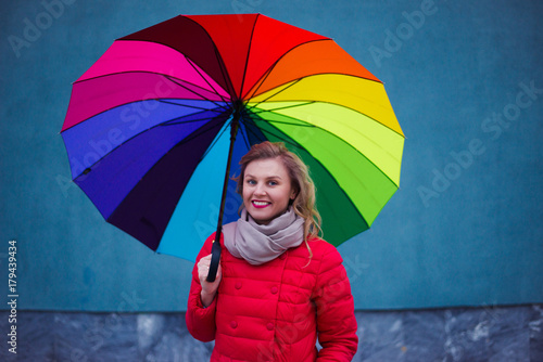 Juliste smiling woman with colorful umbrella