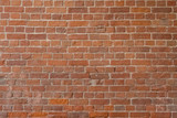 Old red bricks and white cement, wall texture