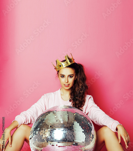 young cute disco girl on pink background with disco ball and cro - 179448068