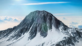 beautiful mountain peak with snow and blue sky, 3d illustration
