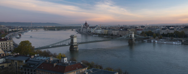 Panorama of cityscape of  Parliament and bridge in morning twilight in Budapest, Hungary