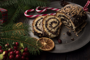 Christmas poppy seed cake on wooden background
