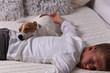 Boy and dog sleeping together. Cozy ,comfy lifestyle