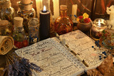 Fototapety Magic book with spells, lavender bunch and black candle on witch table.
