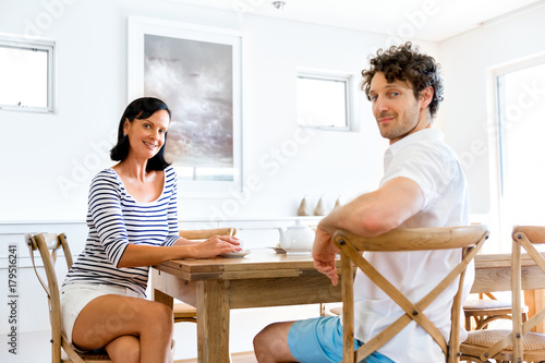 Couple sitting at home and chatting