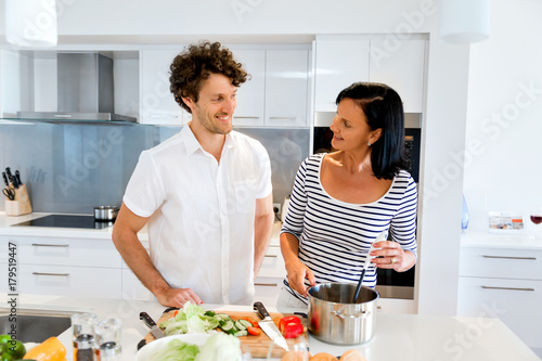 Couple cooking together at home - 179519447