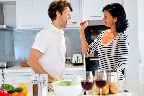 Couple cooking together at home - 179520066
