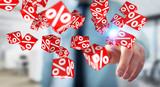 Businessman using white and red sales flying icons 3D rendering