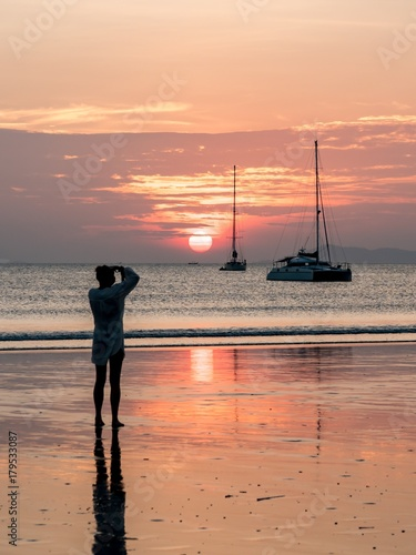 Foto op Canvas Zee zonsondergang Making Ohotos of Sailing Boat and Catamaran at Sunset