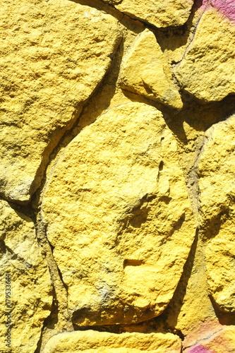 Foto op Canvas Baksteen muur gelb bemalte Steinmauer