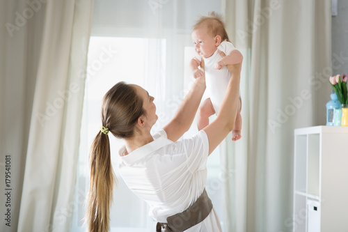 Mom with a newborn baby Poster