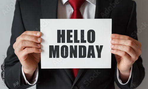 Businessman holding a card with text Hello Monday