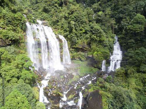Papiers peints Olive Beautiful waterfall.Tad Khamued Waterfall in southern Laos.It is a place to visit the natural beauty.Mountain forest fall landscape.Top view,Aerial view,waterfall amazing nature background,Rainforest