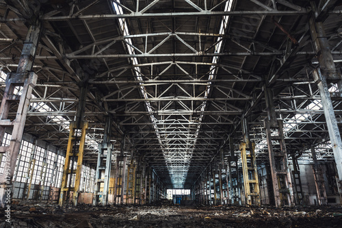 Fotobehang Gebouw in Puin Abandoned metallurgical excavator plant or factory interior, industrial warehouse building waiting for a demolition