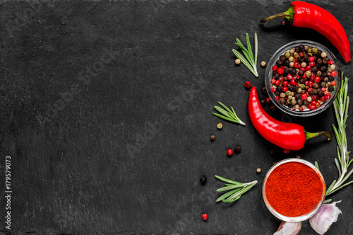 Fotobehang Hot chili peppers Red hot chili peppeprs and peppercorns with rosemary and garlic