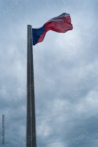Czech Republic flag on the high column under cloudy sky Poster