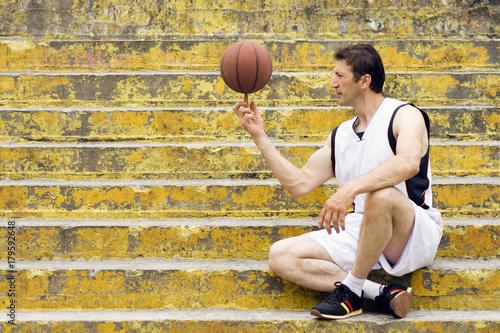 Fotobehang Basketbal basketball player on stairs