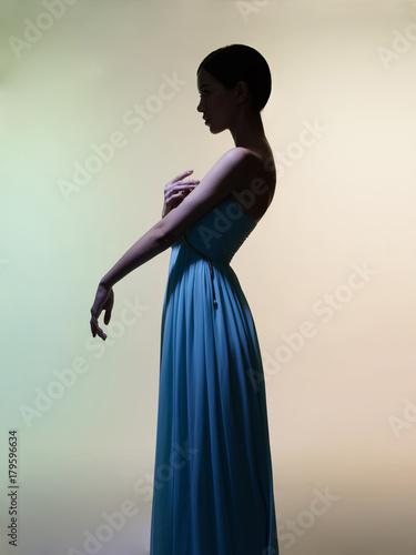 Staande foto womenART Graceful woman in green dress