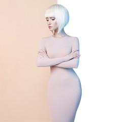 Elegant blonde in geometric beige and white background