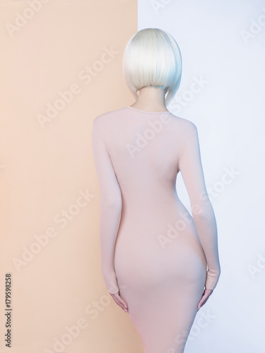 Tuinposter womenART Elegant blonde in geometric beige and white background
