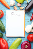 Blank menu book with vegetables on wooden table - 179599218