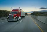 Semi truck on highway at sunset - 179605821