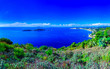 Leinwanddruck Bild - Beautiful summertime panoramic seascape. View of the cliff into the crystal clear azure sea bay and distant islands. Agios Stefanos cape. Afionas. Corfu. Greece.