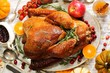 Homemade Thanksgiving Turkey with sides gravy cranberry sauce and autumn vegetables top view - 179617484