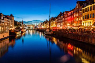 Evening view of Nyhavn district in Copenhagen, Denmark