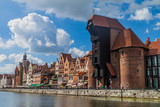 GDANSK, POLAND - SEPTEMBER 2, 2016: Riverside houses by Motlawa river in Gdansk, Poland. Medieval crane in the background.