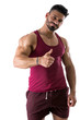 Muscular man shirtless doing thumb up sign for OK, smiling at camera, isolated on white