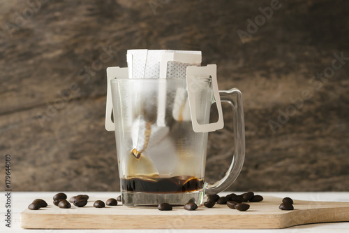 Papiers peints Cafe coffee drip on table with coffee beans