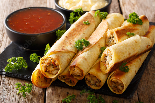 Tasty taquitos with chicken and two sauces close-up. horizontal - 179656866