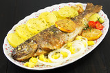 seasoned roasted trout on a plate - 179666669