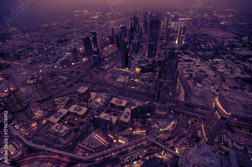 Papiers peints Dubai Dubai skyline with amazing city and highway on traffic with violet colour.