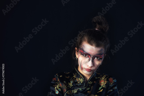Studio portrait of girl with fancy makeup Poster