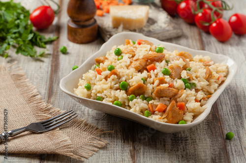 Delicious risotto with chicken and green peas. - 179681429