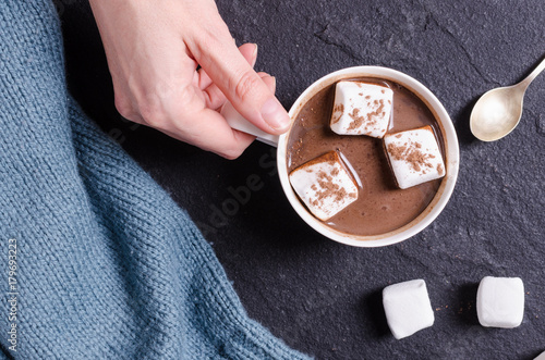 Foto op Canvas Chocolade Hot chocolate with marshmallow in woman hand