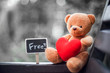 Quadro bear doll and red heart and free plate on the chair  with dramatic tone