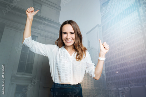 Poster Happy delighted woman showing OK gestures