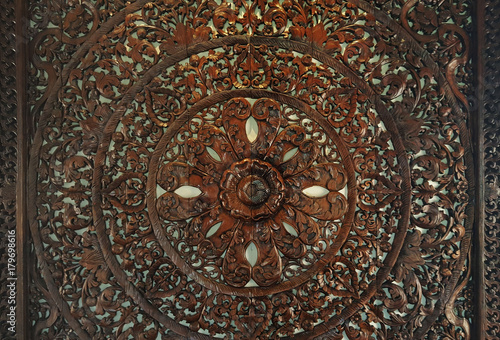 sculptured wood circle decorative spiritual symbol of lotus flower - 179698616