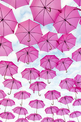 Pink umbrella, on the day of the fight against breast cancer.