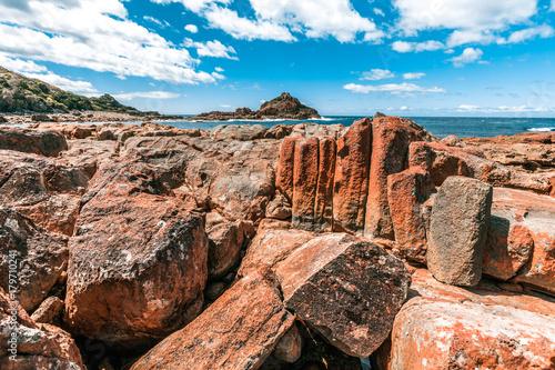 Fotobehang Diepbruine Unusual vivid rock formations in Mimosa Rocks National Park, NSW, Australia