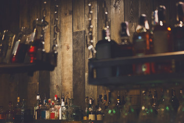 Bar background, wooden wall and drinks