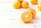 Fresh oranges cut on wooden background