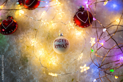 xmas written on a Christmas tree ball, snow, lights Poster