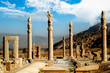 Persepolis is the capital of the ancient Achaemenid kingdom. Ancient columns. Sight of Iran. Ancient Persia. Blue sky and clouds background.