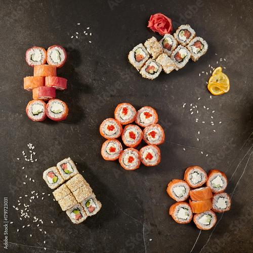 Set of sushi rolls on black background - 179723031