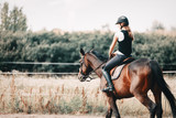 Picture of young girl riding her horse - 179723427