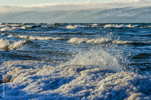 Fotobehang Antarctica frozen sea view. Waves hitting icy coastline